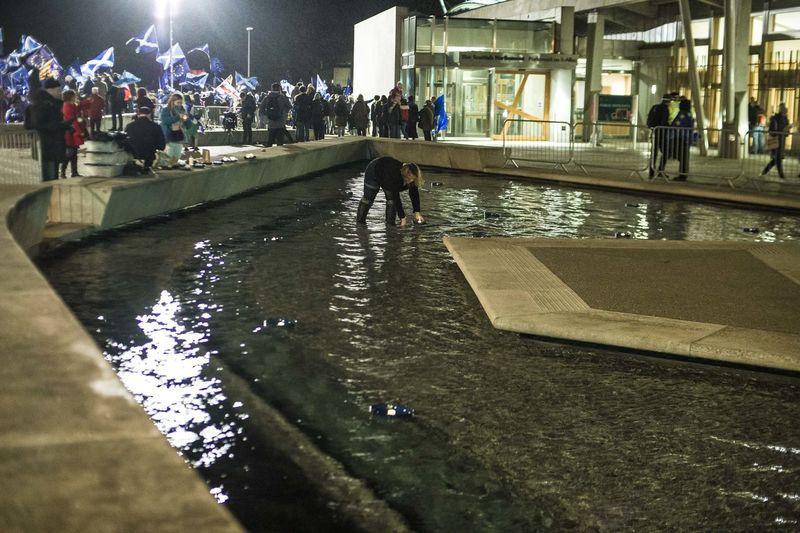 People walking in illuminated city at night