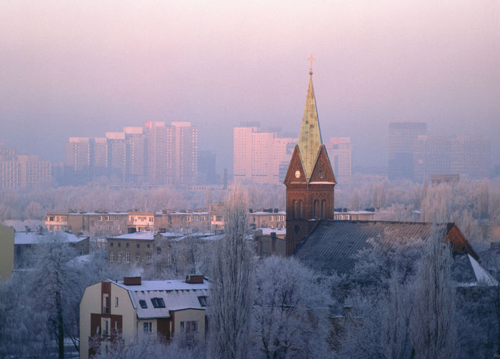 Cityscape against sky during winter