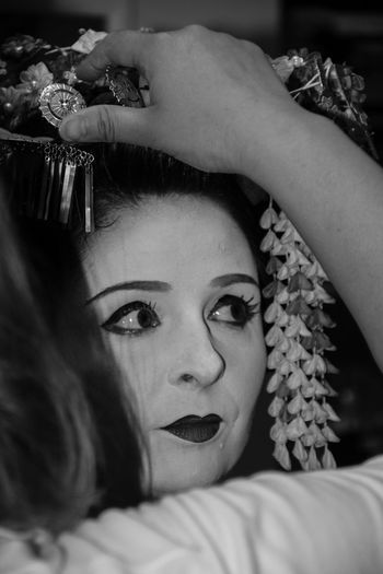Cropped Image Of Beautician Hairstyling Woman During Event