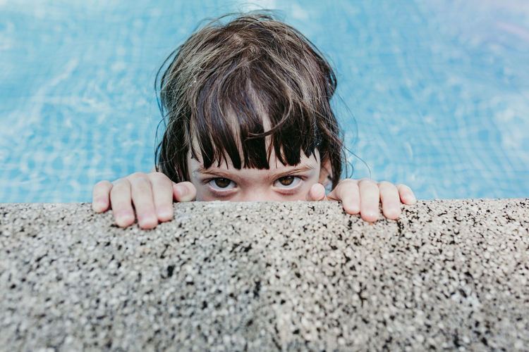 Portrait of girl relaxing in swimming pool
