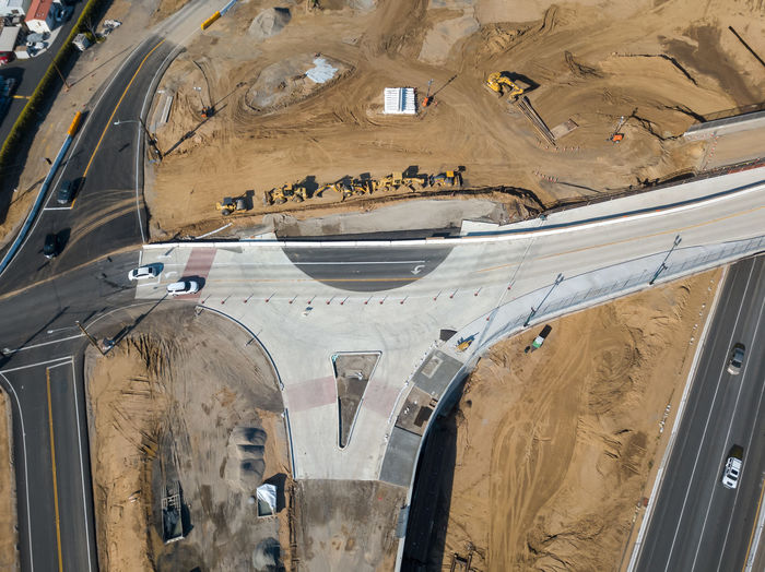 Grand Terrace, CA / USA - 2/24/2019: Aerial view of the Barton Road / 215 Interchange Under Construction High Angle View Transportation Mode Of Transportation Aerial View Architecture No People Motor Vehicle Day Freeway Transportation Overhead View Roundabout Overpass Interchange  Asphalt Concrete Bridge Construction Development