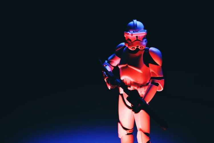 Studio Shot One Person Cyborg Indoors  Copy Space Illuminated Front View Technology Futuristic Standing Clothing Robot Young Adult Helmet Adult Portrait Black Background Strength Light - Natural Phenomenon Star Wars Clone Trooper Clonetrooper Light Painting Star - Space Hobby Toys Scale Model Scale Model Photography