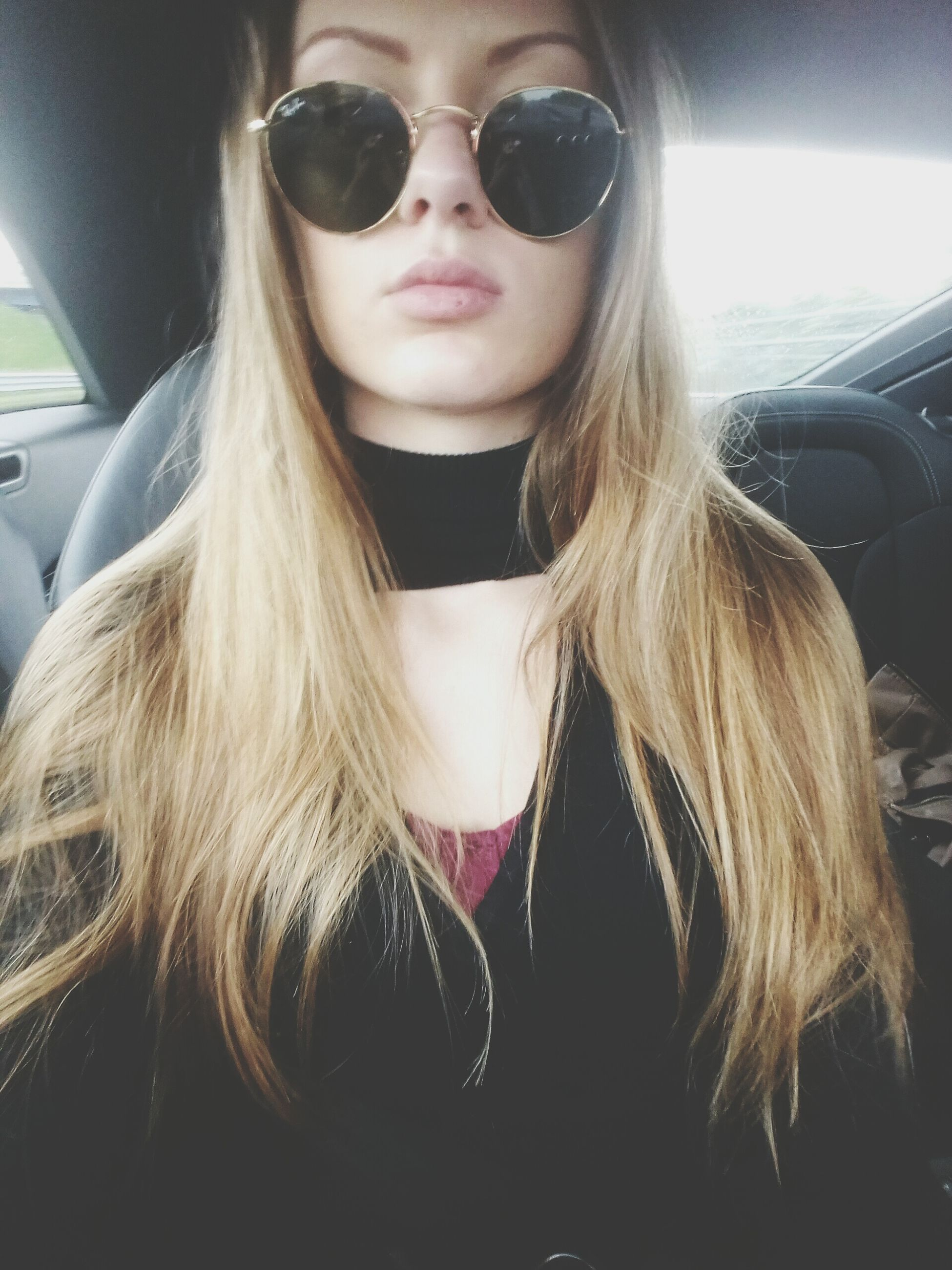 car, vehicle interior, car interior, transportation, land vehicle, mode of transport, one person, real people, front view, looking at camera, long hair, young adult, young women, portrait, lifestyles, day, beautiful woman, close-up, blond hair, outdoors
