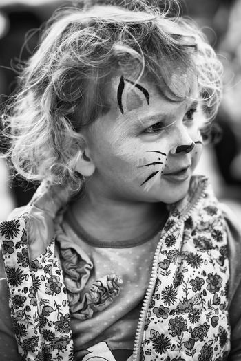 Close-up of girl with animal face paint