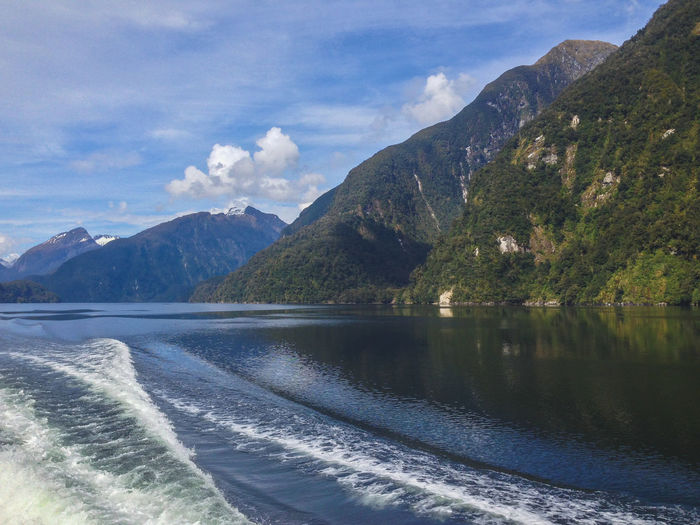 Doubtful Sound cruise - passing beautiful scenery in Fiordland National Park, South Island, New Zealand New Zealand New Zealand Scenery Scenery Nature Landscape Doubtful Doubtful Sound Sound South Island Manapouri Te Anau Cruise Day Trip Outdoors Outside Idyllic Water No People Non-urban Scene Fiord Fiordland Fiordland National Park National Park Southland Cliff Rocks Sea Ocean Mountain Beauty In Nature Sky Scenics - Nature Cloud - Sky Mountain Range Waterfront Day Tranquil Scene Tranquility Land Motion Environment
