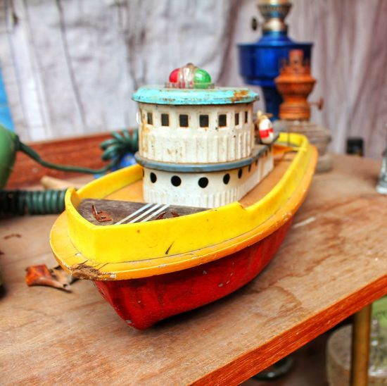Close-up of toy boat on table