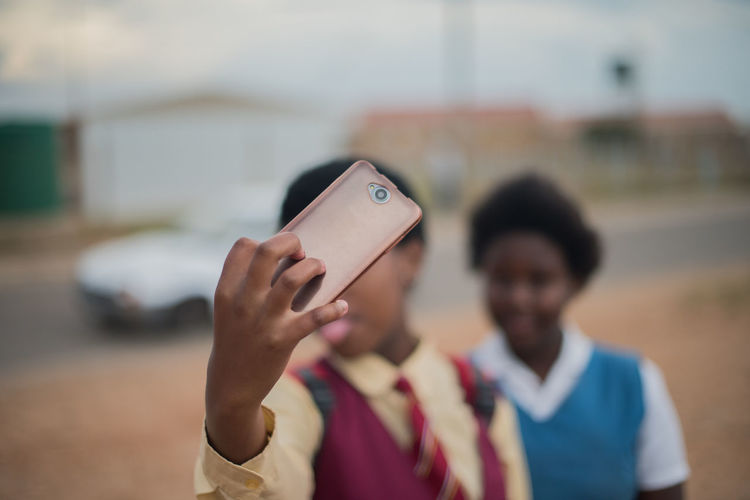 Selfie Childhood Close-up Communication Day Focus On Foreground Holding Human Hand Leisure Activity Lifestyles Mobile Phone Outdoors Photographing Photography Themes Portable Information Device Real People Selfie Technology Togetherness Two People Wireless Technology Women Young Women
