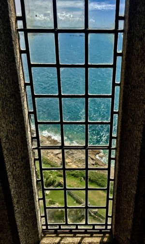Window No People Day Architecture Water High Angle View Sea Built Structure Nature Indoors  Metal Grate Sky Close-up Castle