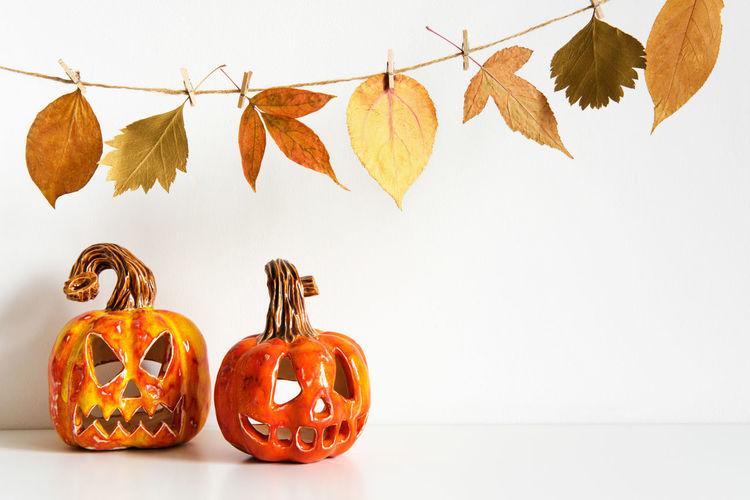 View of pumpkins against orange background