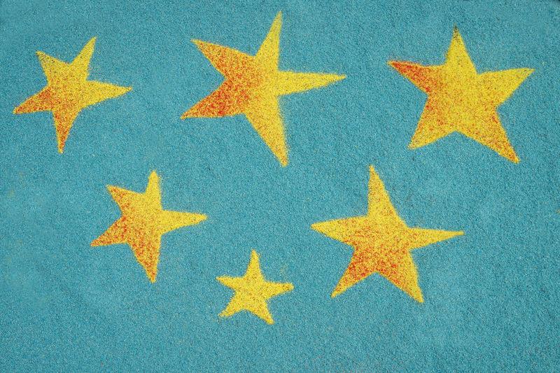 Full Frame Shot Of Yellow Stars On Blue Fabric