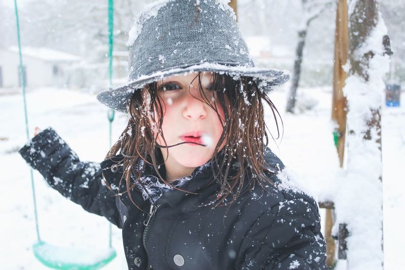 Close-up portrait of girl wearing hat during winter