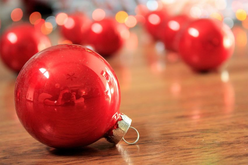 Reflections of the holidays Celebration Celebration Event Christmas Christmas Decoration Christmas Ornament Close-up Holiday - Event Illuminated Indoors  No People Red Shiny