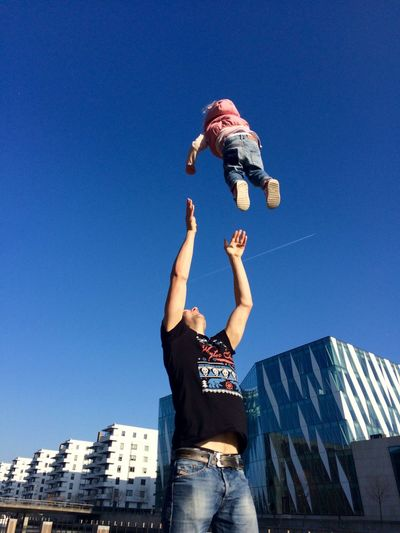 Fun Learning To Fly This Is Fun Dad Daddy's Girl Trust Clear Sky Blue Low Angle View Real People Day Arms Raised Childhood Architecture Playing