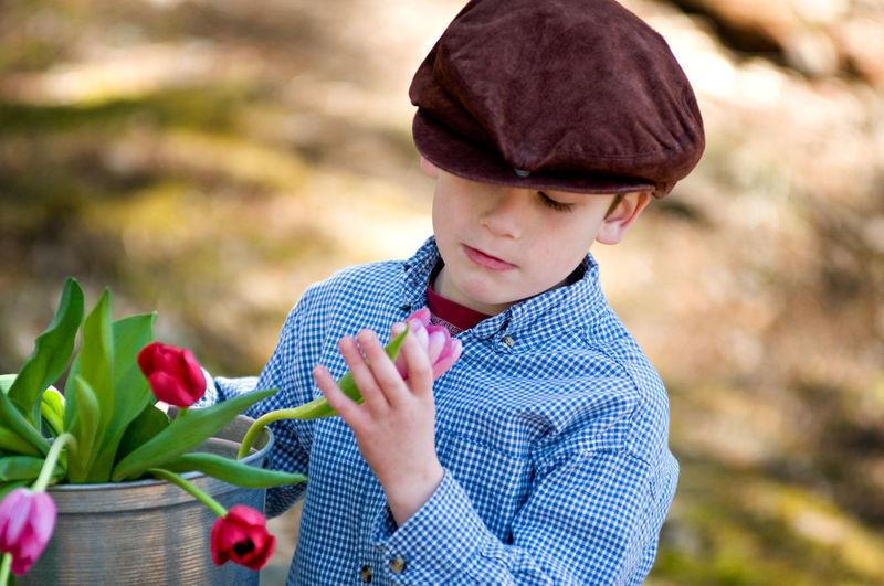 Close-up of boy with flowers