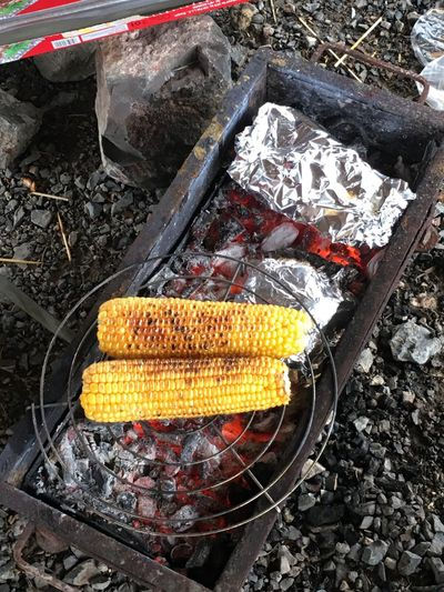 Enjoying the weather and grilling corn