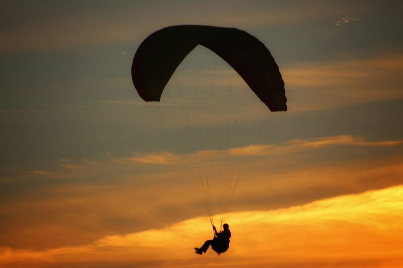 amazing kiters with the spectacular sunset Be Brave Denmark Kitersurfer Photojinicphotography Paragliding Parachute Extreme Sports Flying Sunset Adventure Silhouette Pilot Mid-air RISK Gliding Parasailing