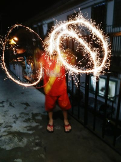 The Photojournalist - 2017 EyeEm Awards Night Boy One Person Standing Fireworks Circle Full Length Light Painting Playing With Fireworks Object Blurred Motion Performance Lights And Shadows The Happiest Moment Ever For A Young Kid Enjoying The Moment Taken By Me