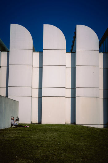 Bauhaus Archives Bauhaus Bauhaus Building Bauhaus Museum Bauhaus Architecture Bauhaus Style Architecture Blue Building Building Exterior Built Structure Clear Sky Day Field Grass Land Modern Nature No People Outdoors Plant Sky Sunlight Wall - Building Feature White Color