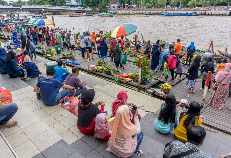 floating market, pasar terapung Traditional Jukung Travel Destination Market Riverside Adult Architecture City Crowd Day Floating Market Group Of People High Angle View Large Group Of People Leisure Activity Lifestyles Men Mixed Age Range Nature Outdoors Real People Relaxation Sitting Spectator Water Women Visiting EyeEmNewHere The Traveler - 2019 EyeEm Awards