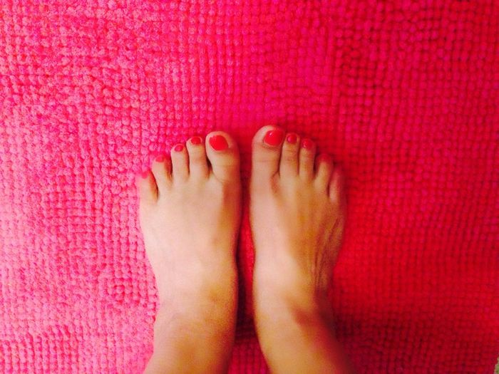 Low Section Of Woman On Pink Mat