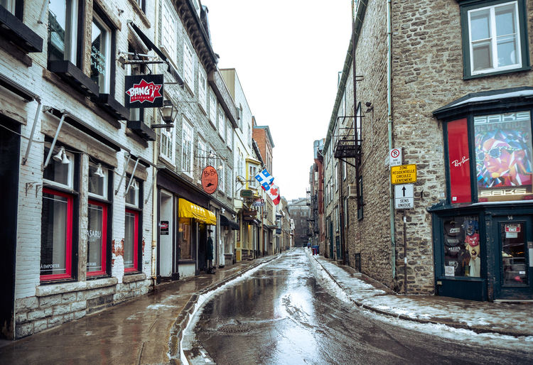 Christmas Old Quebec City Shopping Tourist Attraction  Architecture Building Exterior Built Structure City Cold Temperature Communication Day Destination No People Outdoors Retail  Road Road Sign Sky Street The Way Forward Winter