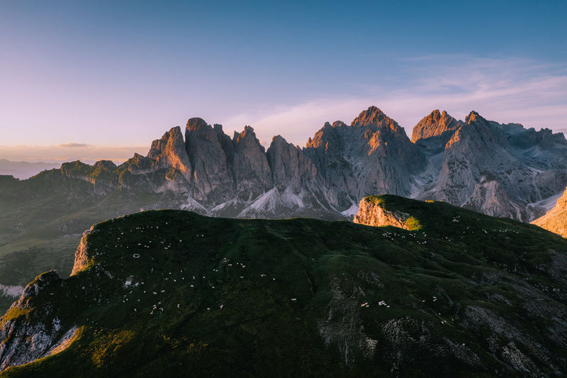 Sunset over Mt Piza in the Italian Dolomites with Seceda in the background. Scenics - Nature Mountain Beauty In Nature Sky Tranquil Scene Sunset Tranquility Mountain Range Nature Landscape Environment No People Cloud - Sky Orange Color Rock Outdoors Physical Geography Mountain Peak Formation Dji Mavic Pro 2 Dolomites, Italy Italy Sheep Seceda
