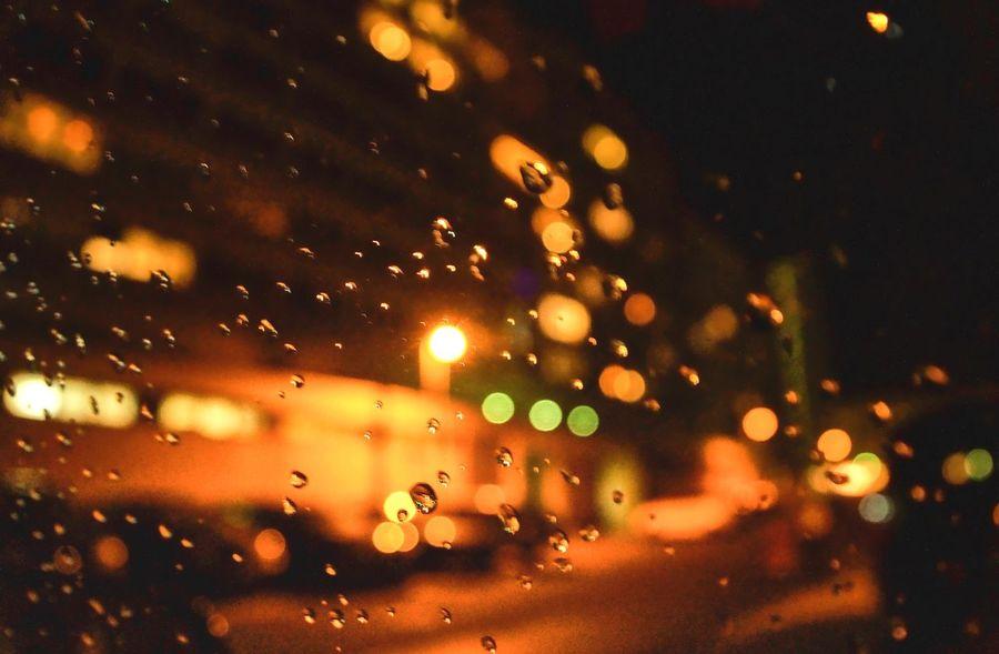 Raindrops on car window City Urban Cold Temperature Raindrops Lights Wanderlust Car Illuminated Drop Wet Night Rain Defocused RainDrop No People Window Water Indoors  Close-up Nature Sky EyeEm Ready   Mobility In Mega Cities