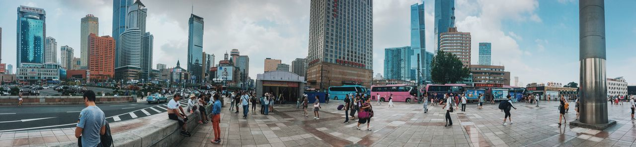 Dalian, Liaoning, China 2017 MelbournePhotographer IPhoneography Streetphotography Mobilephotography Adobelightroommobile Vscocam Panorama ShotoniPhone6s Architecture Built Structure Building Exterior Skyscraper City Large Group Of People Sky Day Transportation Land Vehicle Real People Panoramic Modern Men Outdoors Cityscape Urban Skyline Women Fish-eye Lens People