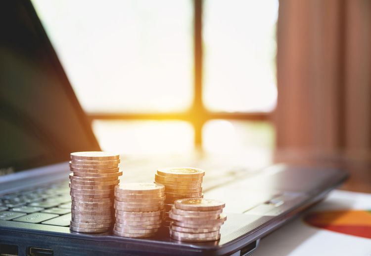 Business Close-up Coin Container Currency Day Economy Finance Focus On Foreground Food And Drink Indoors  Large Group Of Objects No People Stack Still Life Sunlight Table Wealth Window