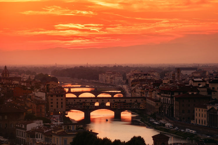 The city of Florence at dawn with a view of the old bridges over the river Arno Architecture Arno  City Firenze Florence Italy Florence, Italy Ponte Vecchio - Firenze Renaissance Romantic Tourist Attraction  Tuscany Aerial Building Florence Italian Italy🇮🇹 Landmark Ponte Vecchio Renaissance Architecture River Sunset Sunset #sun #clouds #skylovers #sky #nature #beautifulinnature #naturalbeauty #photography #landscape Tourism Tourist Destination Tuscany Italy