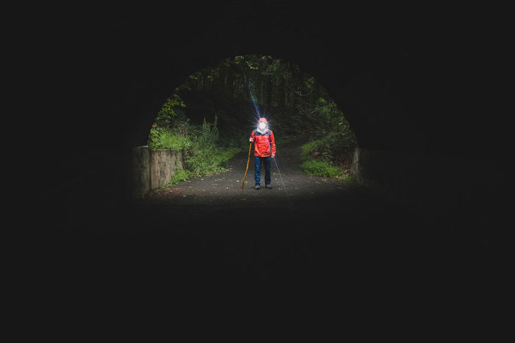 I am the light at the end of the tunnel. One Person People Adult Black Background Outdoors Real People Day Photography Travel Unrecognizable Person Self Portrait Selfie ✌ Light And Shadow Tunnel Light Hike Hiker Nature The Great Outdoors - 2017 EyeEm Awards The Way Forward Creativity Popular Photos Beauty In Nature Scenics Dark