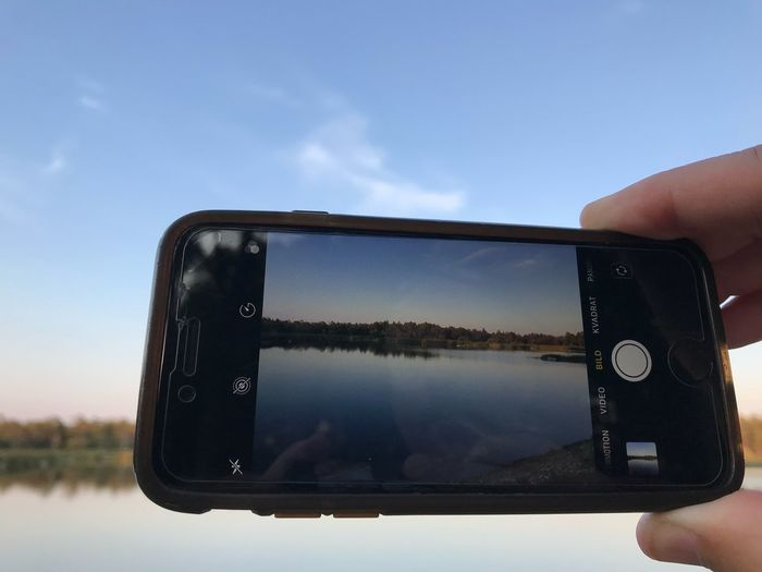 Photo in photo Human Hand Hand Sky Human Body Part Holding One Person Photography Themes Human Finger Finger Nature Real People Cloud - Sky Body Part Communication Water Personal Perspective