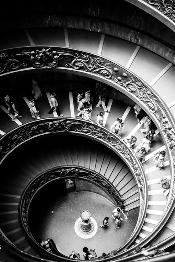High Angle View Of People On Spiral Staircase At Vatican Museums