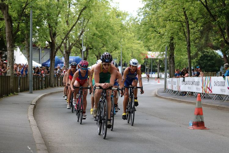 Adults Only Athlete Bicycle Chateauroux Competition Crowd Cycling Day ETU Sprints France Healthy Lifestyle Large Group Of People Outdoors People Racing Bicycle Sports Race Tree Triathlete TRIATHLON