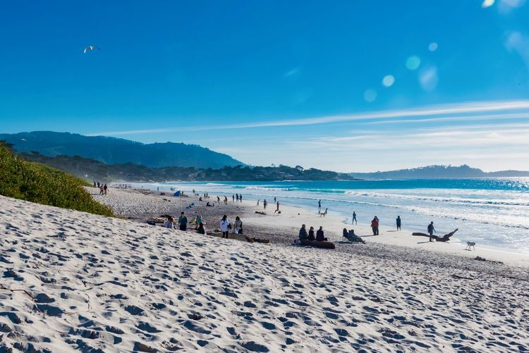 Beach Sea Land Group Of People Water Sky Crowd Sand Holiday Large Group Of People Real People Vacations Trip Beauty In Nature Nature Day Scenics - Nature Mountain Men Outdoors