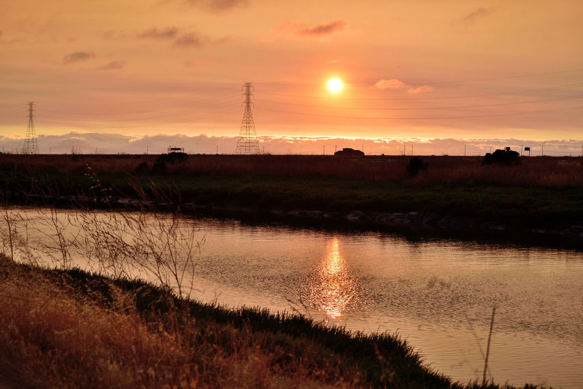Sunset At Eden Landing 9 Marsh Eden Landing Ecological Reserve Tidal Wetlands Wildlife Refuge Channel Salt Pond Restored Marshlands Sundown Sunset Sunset Silhouettes Sunset Collection Sun's Glow Reflection Reflections In The Water Power Pylons & Lines Marine Layers! Fog Telephone Poles Landscape_Collection Nature Nature_collection Beauty In Nature Landscape_photography Moody Sky