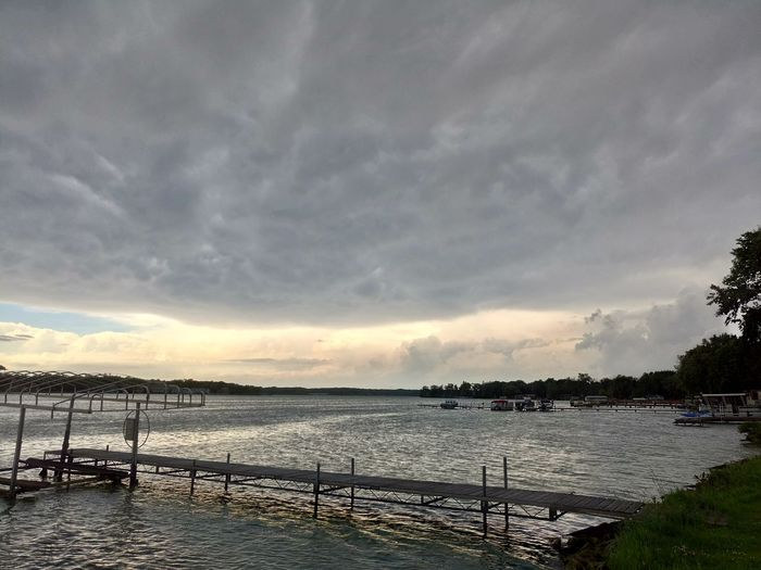 About To Storm Amazing Beauty In Nature Before Rain Big Sky Calm Waters Cedar Lake Cloud - Sky Clouds And Sky Cloudy Day God County Gray Scale  Lake Nature No People Nofilter Outdoors Pontoon Pretty Scenics Sky Sun Peeking Through Tranquil Scene Tranquility Water First Eyeem Photo