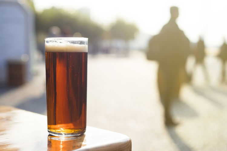 """Drinking an """"altbier"""" (old beer in german) in Dusseldorf's old town, Germany. ALTBier Beer Bier Cityscape Düsseldorf Old Town Relaxing Summertime Sunny Travel Alt Bier German Beer Glass Old Town Square Summer Sunset Travel Destinations"""