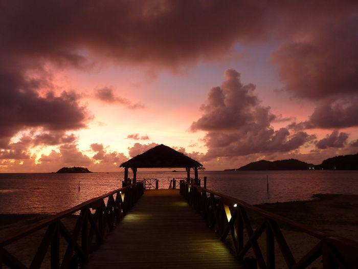 Fiji Tropical Paradise Tropical Island Water Sky Cloud - Sky Sunset Sea Architecture Scenics - Nature Tranquil Scene Tranquility Beauty In Nature Built Structure Pier Direction Nature The Way Forward Jetty Railing No People Gazebo Outdoors