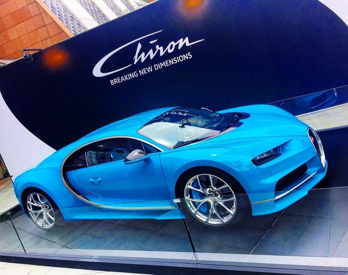 Bugatti Chiron Supercar on display at the Amber Lounge party reception in Singapore Bugatti Bugatti Chiron Supercar Supercars SupercarsofLondon Supercars Of Singapore Limitededition 500 Mode Of Transport Transportation Land Vehicle Car Road Travel Stationary Blue Day Outdoors No People Rainy Journey Rush Hour City Life