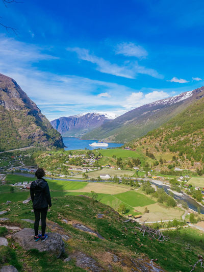 Lost In The Landscape Norway Adventure Beauty In Nature Day Fjord Full Length Hiking Landscape Lifestyles Men Mountain Mountain Range Nature One Person Outdoors People Real People Rear View Scenics Sky Tranquil Scene Tranquility Women