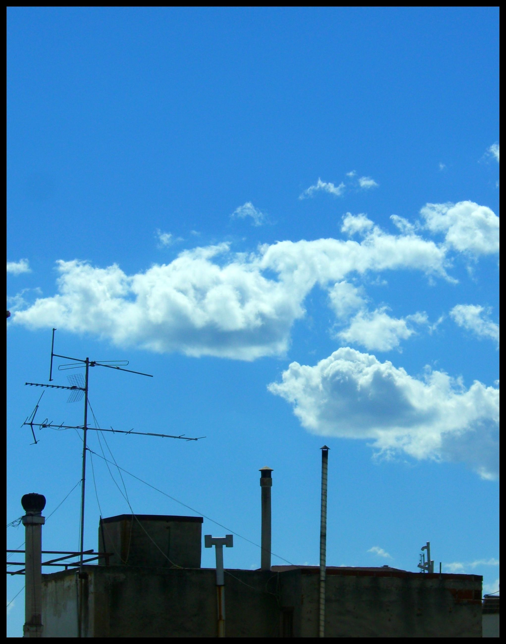 sky, low angle view, blue, built structure, building exterior, architecture, cloud, transfer print, cloud - sky, power line, auto post production filter, silhouette, electricity pylon, outdoors, industry, street light, no people, copy space, day, pole