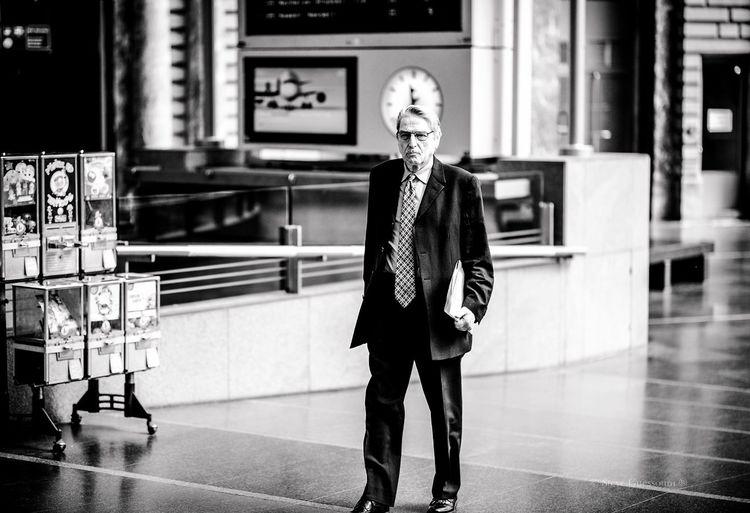 Portrait of mature man standing in corridor