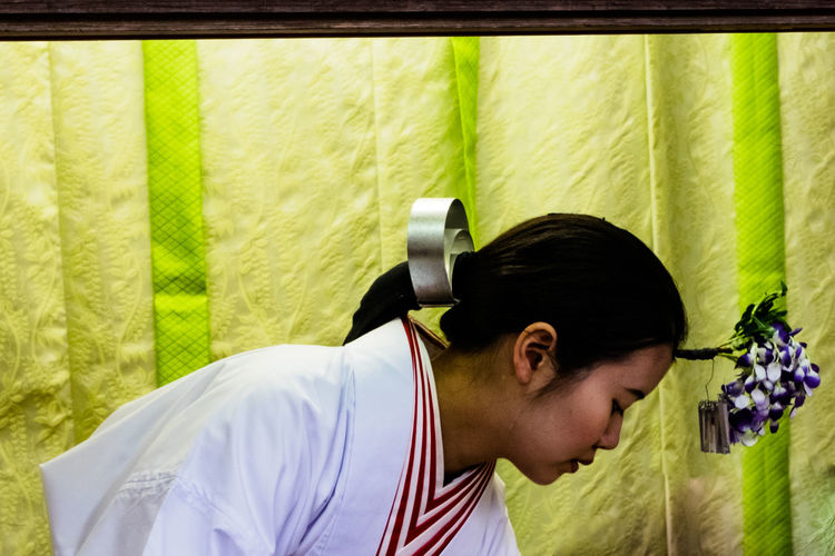 Close-up side view of young woman