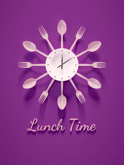 Optical illusion of clock made with plate and cutlery over purple background