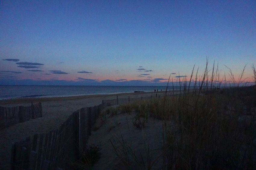 Early evening on the beach as the sun sets. Rehoboth Beach United States On The Beach Vanishing Point