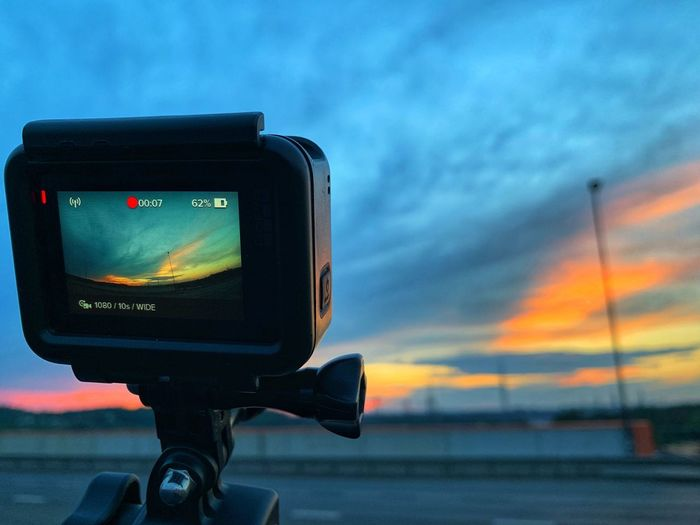 Technology Sky Cloud - Sky No People Photography Themes Communication Nature Photographic Equipment Digital Camera Lighting Equipment Low Angle View Outdoors Close-up Device Screen Dramatic Sky Focus On Foreground Equipment Sunset Camera - Photographic Equipment Screen