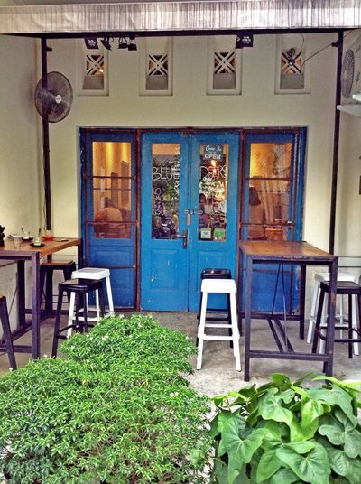 Heritage Building Architecture Coffee Shop why this cafe named Blue Doors
