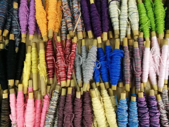Full Frame Shot Of Colorful Thread Spools For Sale In Market
