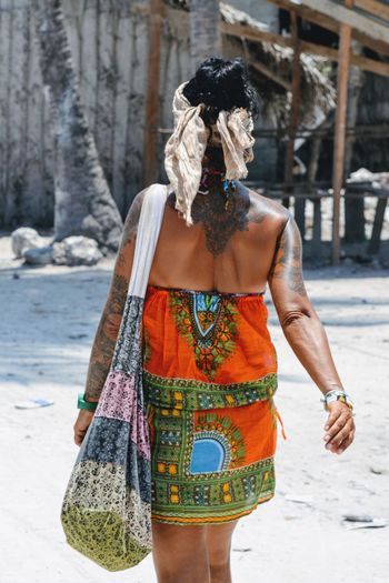 Walking woman Tattoo Skin Zanzibar Africa One Person Three Quarter Length Standing Clothing Adult Day This Is My Skin Lifestyles Women Fashion Mature Adult Outdoors Nature Hairstyle Headdress Beautiful Woman The Street Photographer - 2018 EyeEm Awards Urban Fashion Jungle #urbanana: The Urban Playground